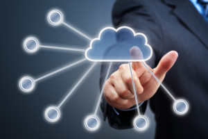 Businessmans hand pressing cloud icon on visual touch screen concept for cloud computing